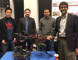 Professor Kumar (R) poses with the drone research team